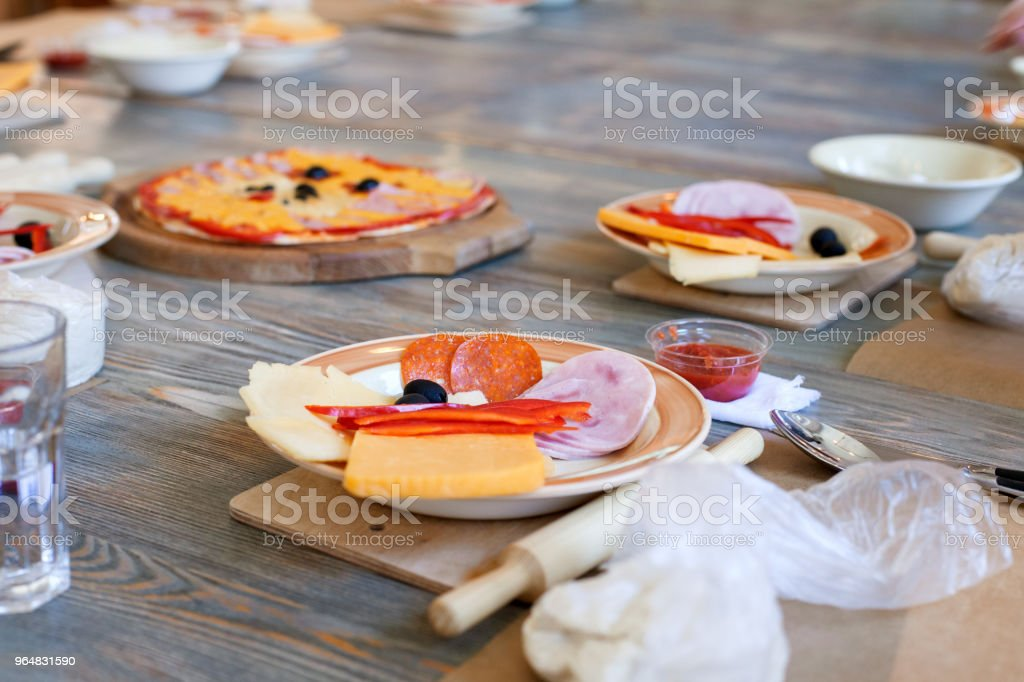 cooking class, culinary. food and people concept, desktop getting ready for work, ingredients for italian pizza royalty-free stock photo