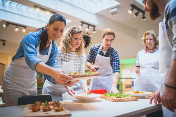 Cooking class participants enjoying cooking class picture id923614306?b=1&k=6&m=923614306&s=612x612&w=0&h=idsrhsxjx a3xxkiwwwvzl0gujmyrtsiaw4ymiwacjg=