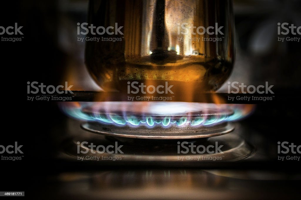 cooking coffee on gas stove stock photo