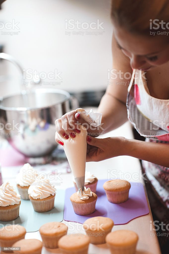Cooking creamy cupcakes stock photo