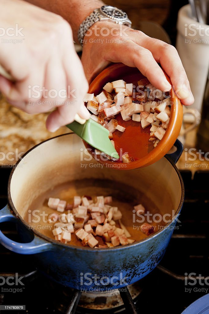 Cooking Diced Bacon royalty-free stock photo