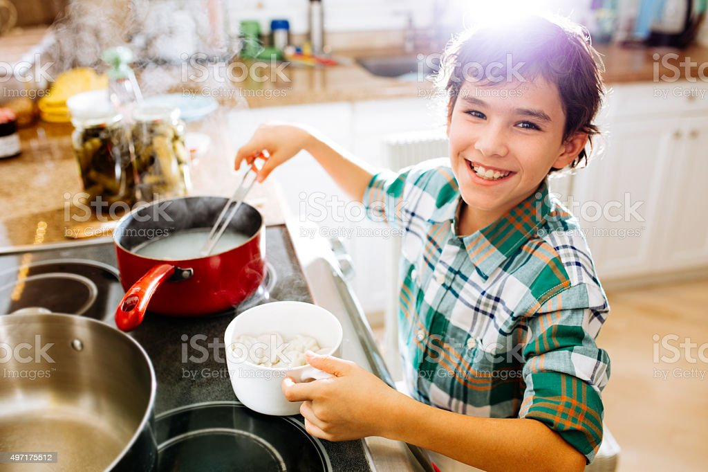 Cooking dumplings for my family stock photo