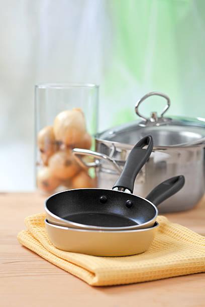 cooking equipment on wooden table - silberzwiebeln stock-fotos und bilder