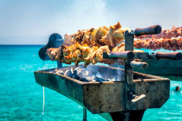 Cooking fresh Cypriot souvla on the sea stock photo