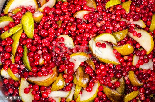 Cooking  fresh pear and cranberry. Studio Photo