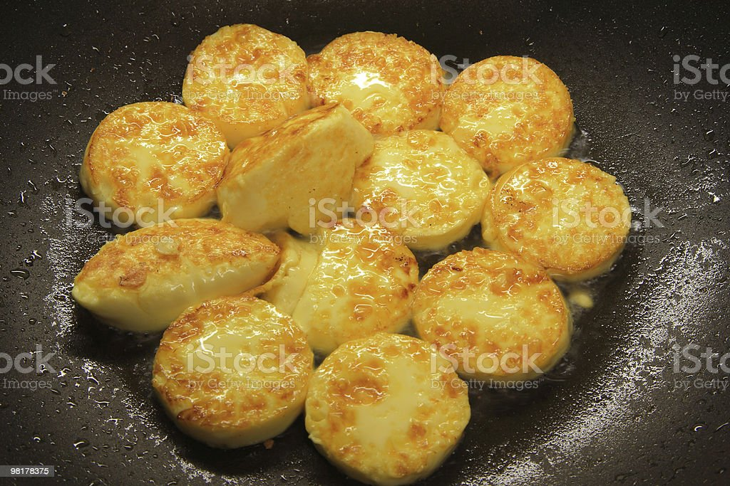 Cooking Golden Tofu in the Pan royalty-free stock photo