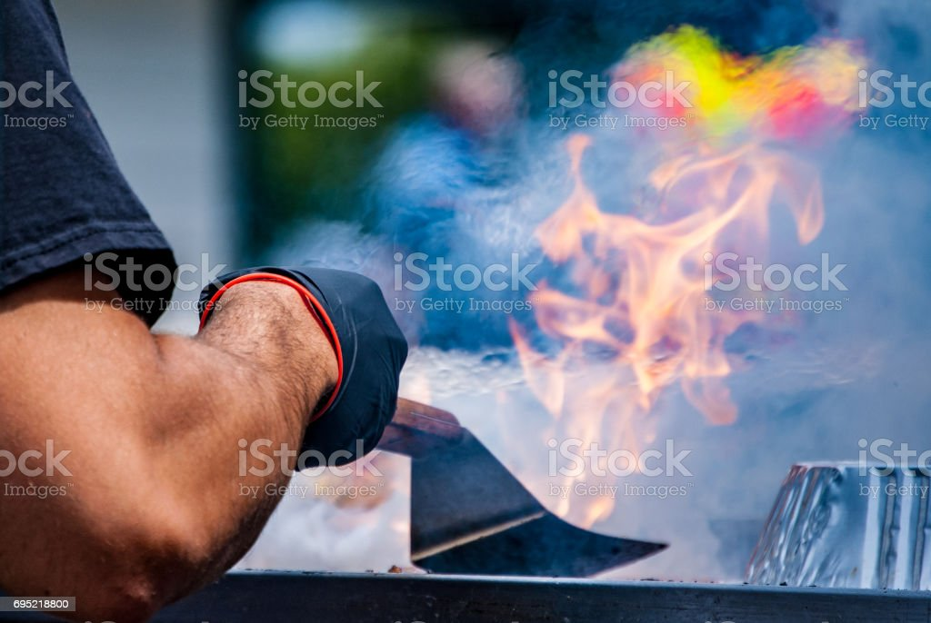 Cooking hamburgers at an outdoor festival stock photo