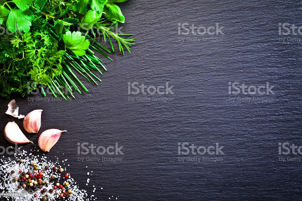 Cooking: herbs, salt, pepper and garlic stock photo
