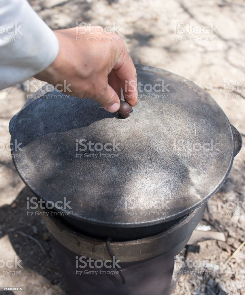 cooking in a cauldron on the nature stock photo