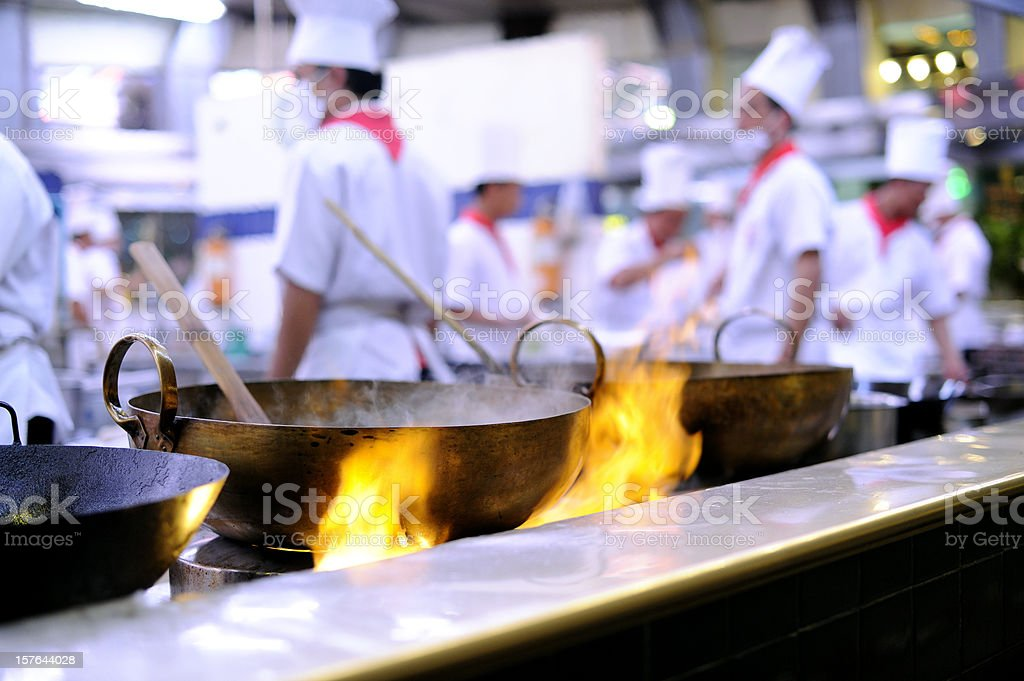 Cooking in a commercial kitchen stock photo