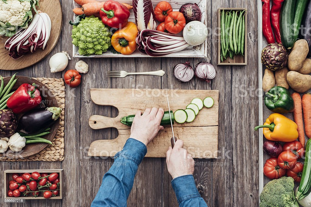 Cooking in a rustic kitchen stock photo
