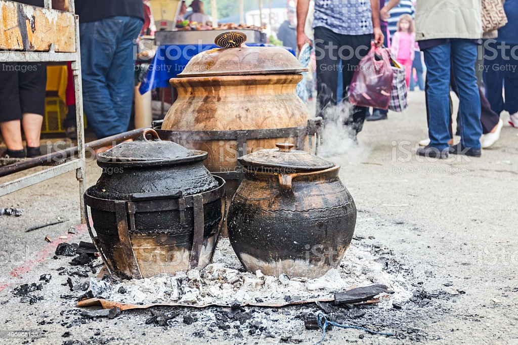 Cooking in ceramic pots royalty-free stock photo