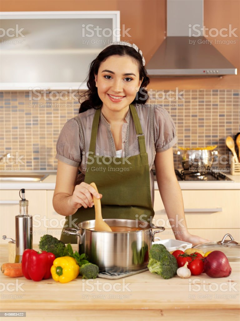 cooking in domestic kitchen stock photo