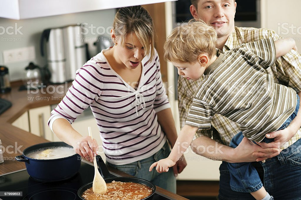 Cooking in family - stirring the sauce royalty-free stock photo