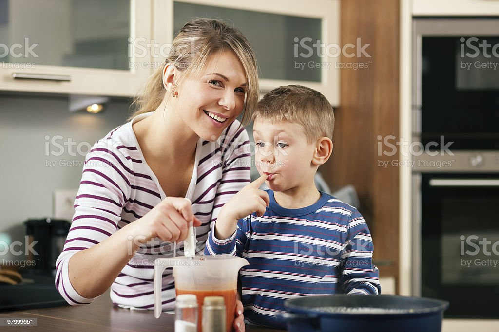 Cooking in family - tasting the sauce royalty-free stock photo