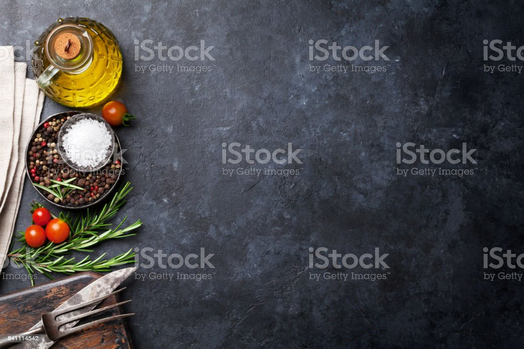 Cooking ingredients and utensils on stone table stock photo