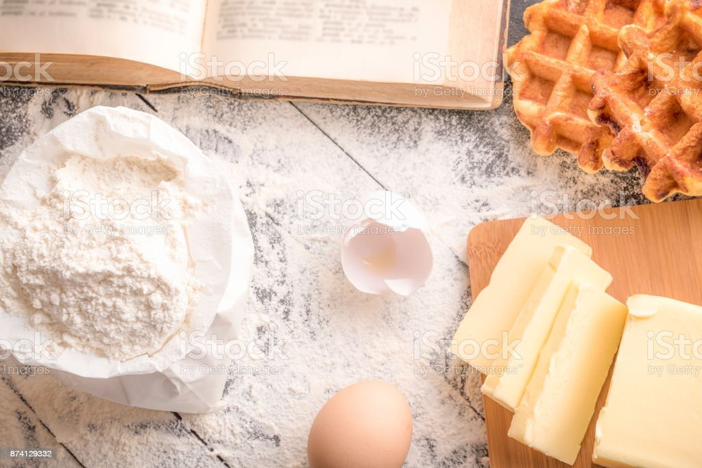 Cooking ingredients and waffles stock photo