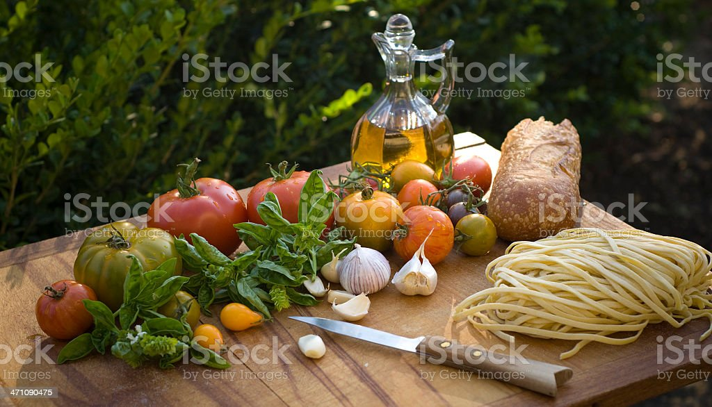 Cooking Ingredients for Spaghetti, Olive Oil, & Heirloom Tomatoes Vegetables royalty-free stock photo