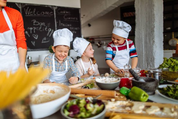 cooking is fun! - kids cooking stock photos and pictures