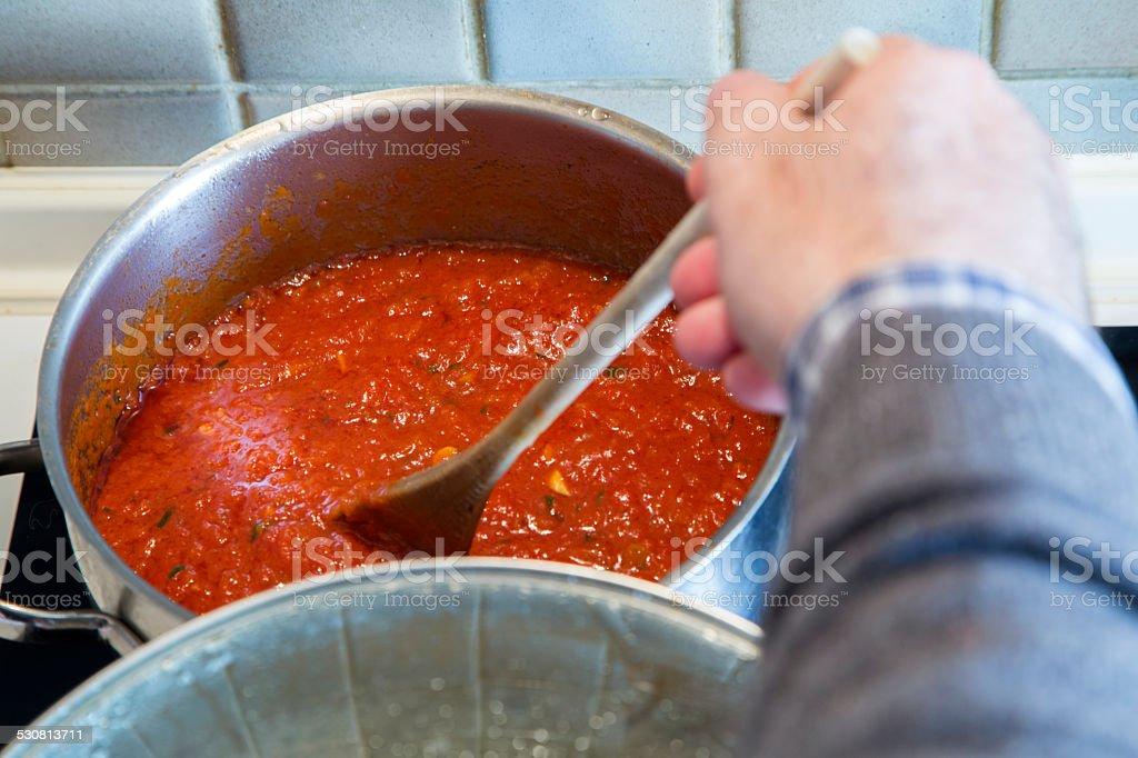 Cooking italian tomato sauce stock photo