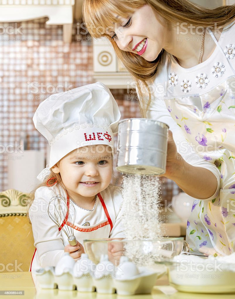 Cooking lesson for little daughter stock photo