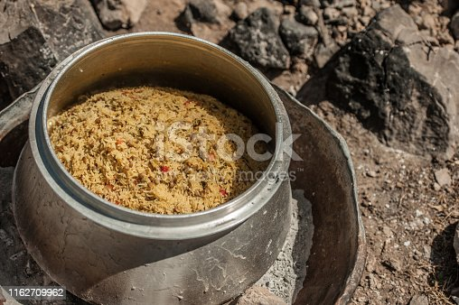 Iranian Nomads Cooking Lunch Outdoors in Iranian Desert, Rice with Lentil, Saffron and Mountain Herbs