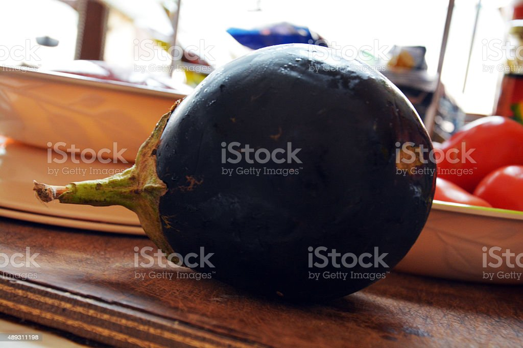 Cooking Maloubi -Eggplant and tomatoes stock photo