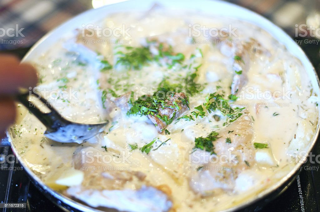 cooking meat in a creamy sauce stock photo