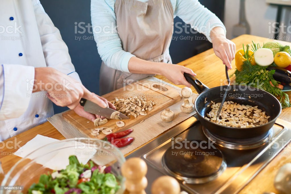 Cooking mushrooms - Royalty-free Adult Stock Photo