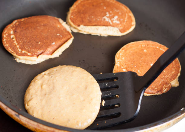 Cooking of paleo apple-cinnamon pancakes stock photo