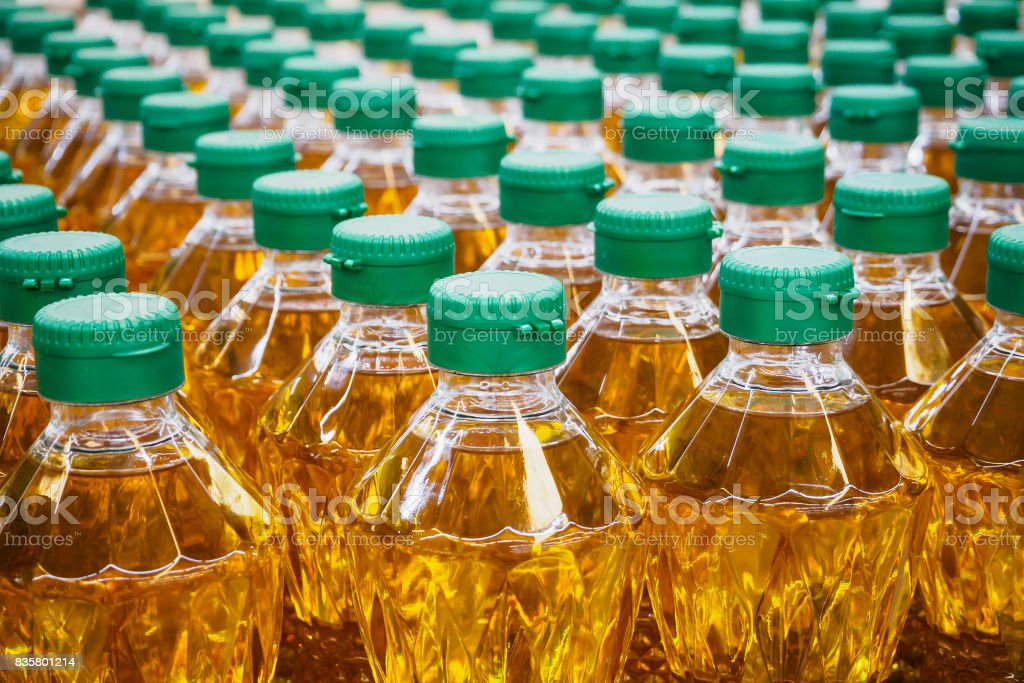 Cooking oil bottles at factory warehouse stock photo