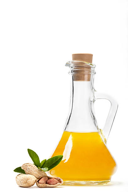Cooking oil with nuts near a bottle stock photo