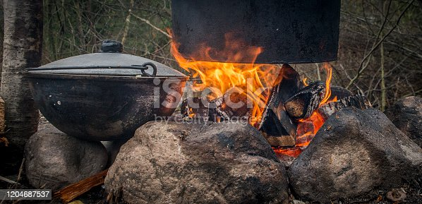 Cooking on a fire.