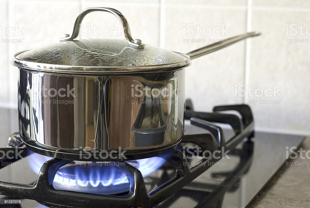 Cooking on a gas stove stock photo