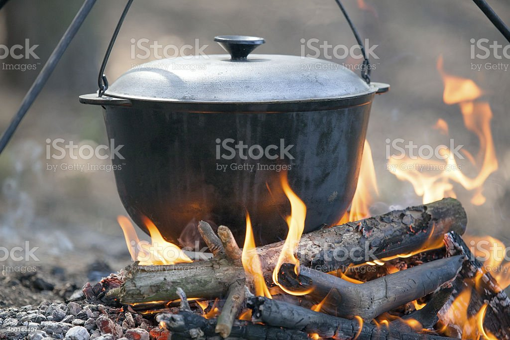 Cooking on campfire. stock photo