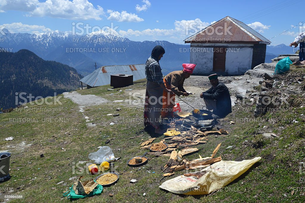 Cooking on top of a hill stock photo