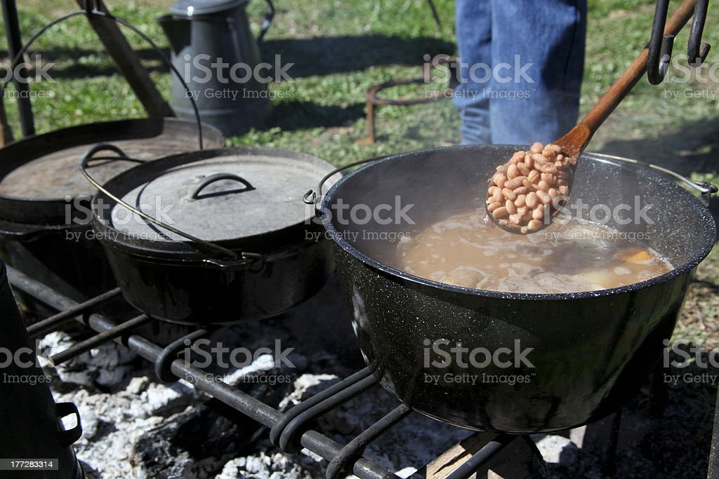 Cooking Over a Fire stock photo