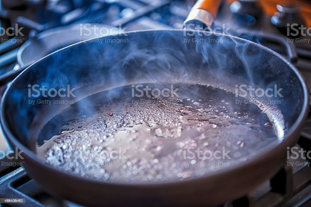Cooking Pan with Hot Frying Oil stock photo