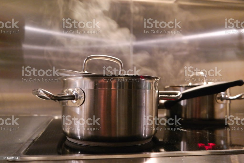 cooking pan with steam stock photo