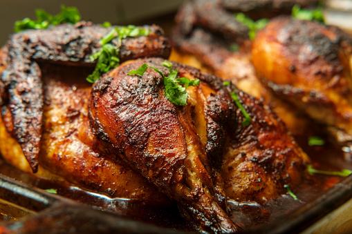Cooking pan Peruvian roasted half chicken pollo a la brasa