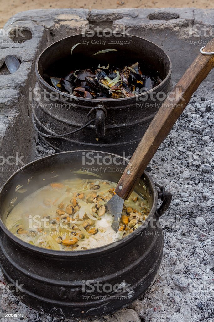 cooking pot with food stock photo