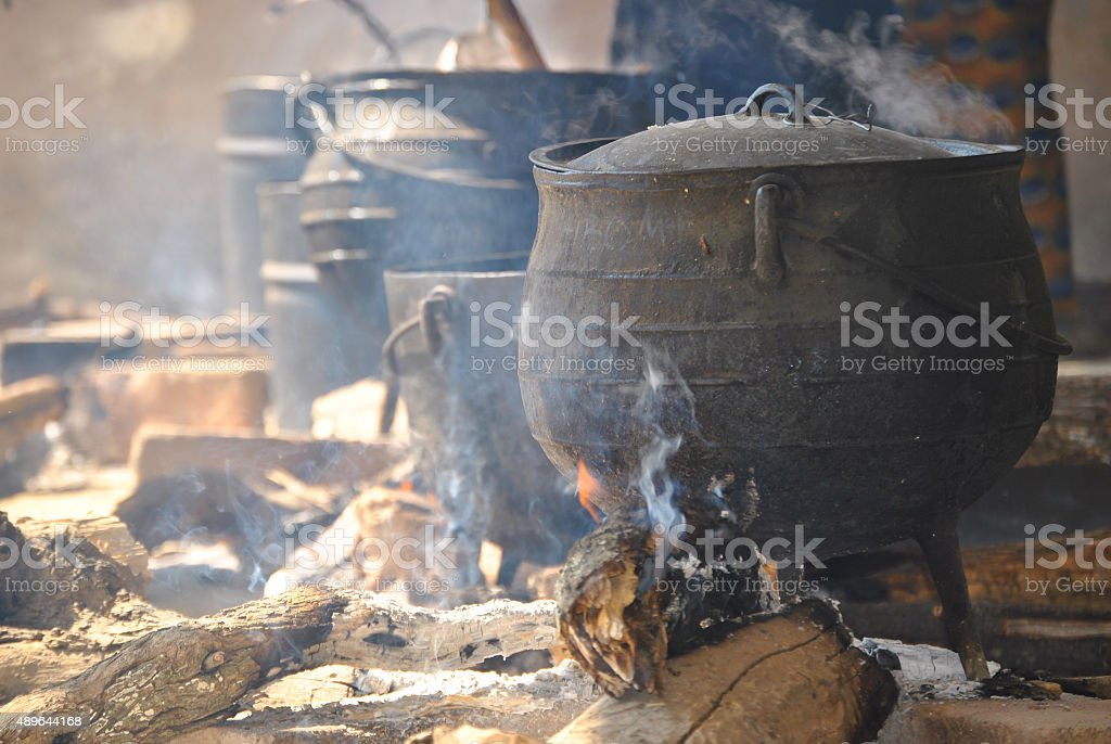 cooking pots on a fire stock photo