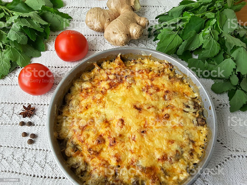 Cooking quinoa mushroom ginger gratin, organic food with weed стоковое фото
