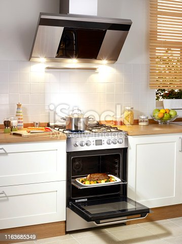 electric stove with food inside in a domestic kitchen