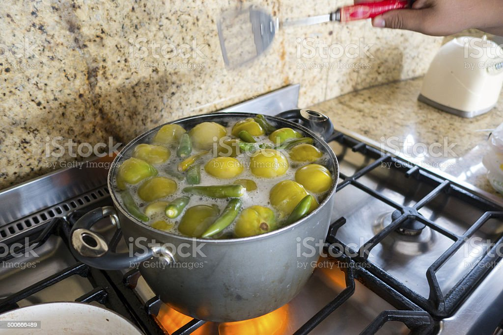 Cooking Salsa Verde in Mexico stock photo
