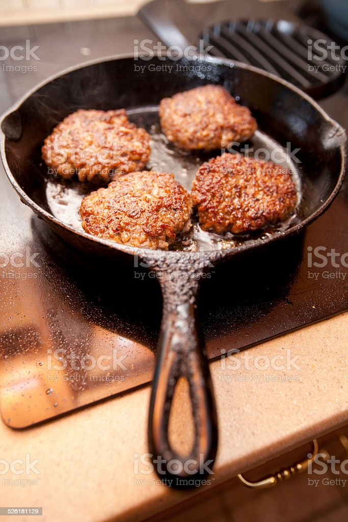 Cooking Sausage stock photo