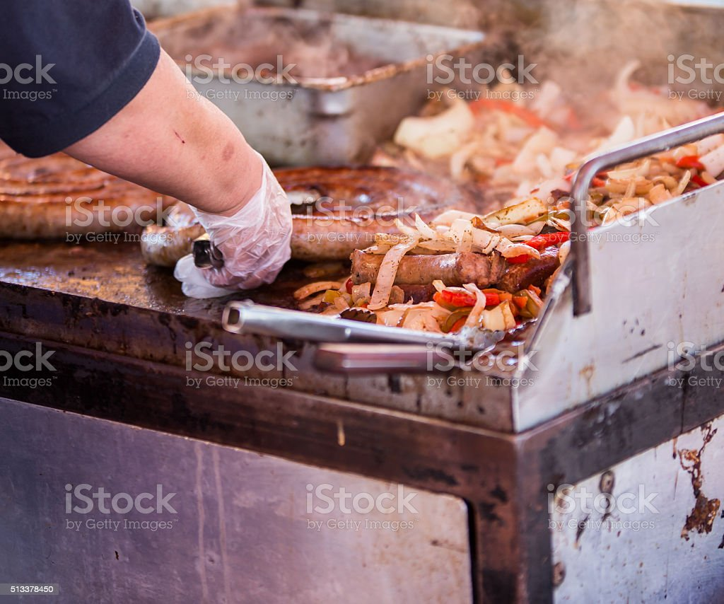 cooking sausages and onions stock photo