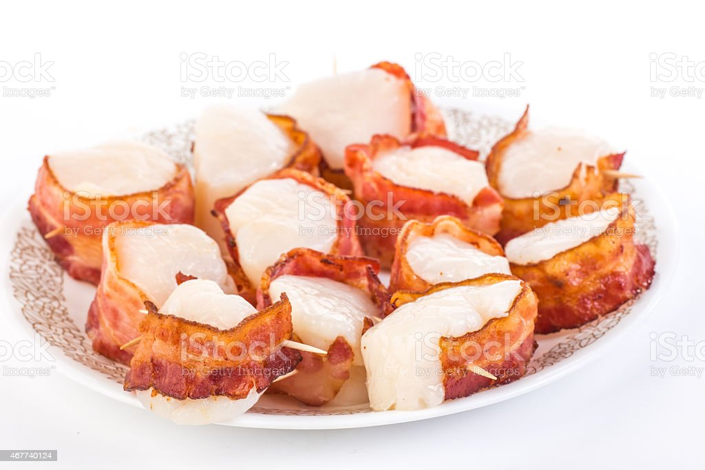 Cooking Scallops in Bacon Wrap stock photo