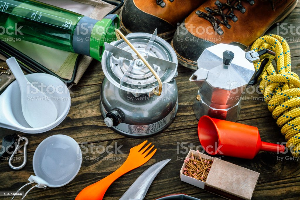 Cooking set . Travel equipment and accessories for mountain hiking trip on wood floor stock photo