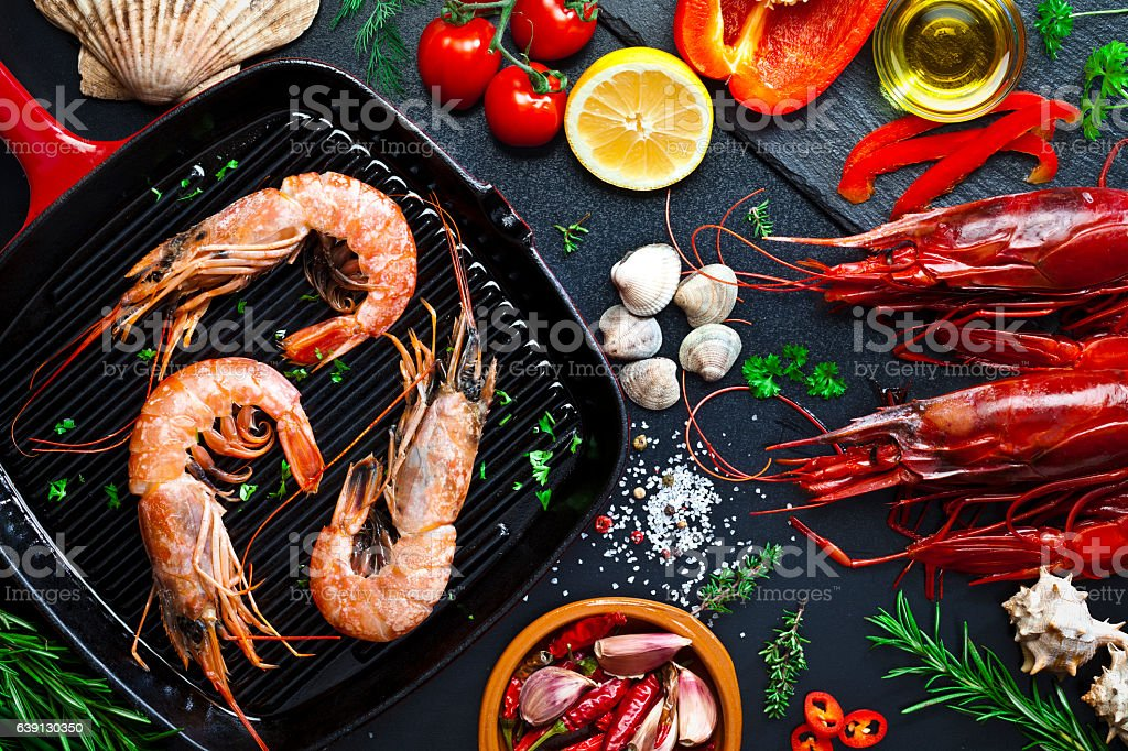 Cooking shrimps in a grill stock photo